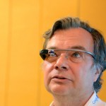 ETer David Cardinal looking up to get a new notification from Google Glass, photo by Sergey Brin